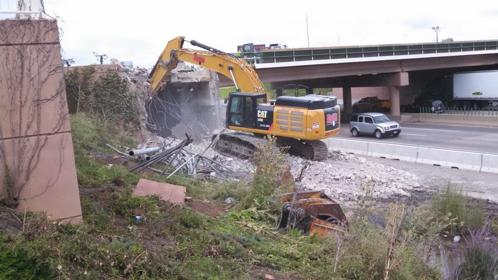 wrecking contractor helps to expand roadway